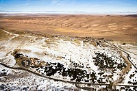 Aerial landscape of snowy plains and dunes in Great Sand Dunes National Park, Colorado (thumbnail)