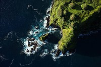 Aerial of rocky coast on Pacific ocean in Maui, Hawaii