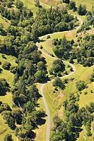 Aerial of road curving through rural landscape
