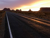Scenic sunset landscape of highway in Monument Valley on the border of Arizona and Utah, United States