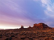 Scenic landscape at dusk of mesas in Monument Valley near the border of Arizona and Utah, United States