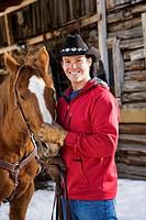 Cowboy petting horse