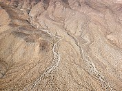 Aerial view of torrid California desert with rocky landforms