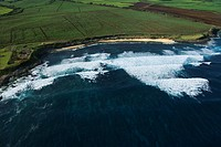 Aerial view of surf spot on coast of Maui, Hawaii with waves
