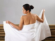 woman wrapping herself in a towel