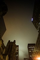 Foggy night view of high rise buildings, church (thumbnail)