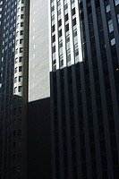 High rise office buildings side by side, partially obscurred by shadow, cropped (thumbnail)