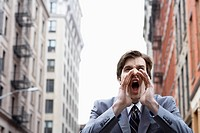 Businessman shouting on street