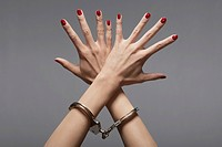 Woman's hands in handcuffs close-up (thumbnail)