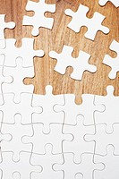 Jigsaw puzzle on wooden background (thumbnail)
