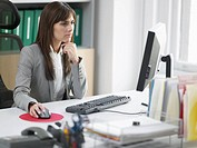 Worried Female Office Worker at Desk