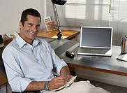 Mid Adult Businessman at Desk