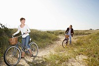 Couple cycling in field (thumbnail)