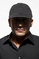 Man in black shirt and cap, portrait