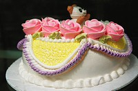 Birthday cake decorated with pink roses