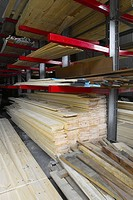 Stacked wood in timber merchant warehouse (thumbnail)