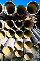 Stack of pipes on building site