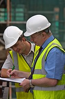 Construction managers on building site