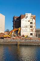 Old factory being demolished for the regeneration of London Docklands area, UK