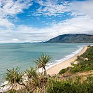 Scenic coastal view from Queensland Rex Lookout with mountains in background and grassy vegetation in foreground