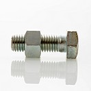 Nut and bolt against white background