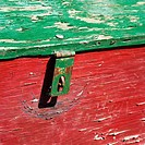 Old red and green weathered wooden storage container