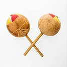 Pair of handmade Mexican maracas percussion musical instruments against white background (thumbnail)