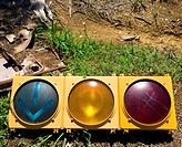 Old traffic light on ground