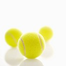Three tennis balls.