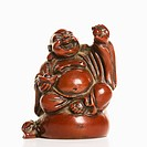 Happy laughing Buddha figurine with hand raised in blessing on white background