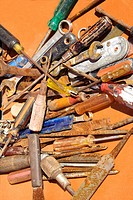 Old rusty tools lying on table