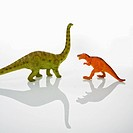 Plastic toy Tyrannosaurus and Apatosaurus dinosaurs (thumbnail)