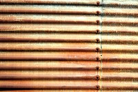 Side of building with old rusted corrugated metal