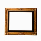 Empty gold colored fancy picture frame