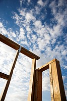 Frame wooden structure with cloudy blue sky in background