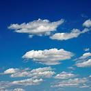 Peaceful clouds in blue sky.