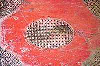 Old red patterned piece of metal