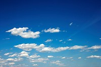 Fluffy clouds in blue sky