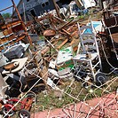 Chaotic mess of junk strewn across junkyard outdoors
