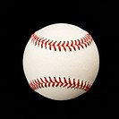 Still life of baseball on black (thumbnail)