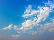 Skyscape of blue sky and white fluffy clouds
