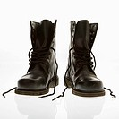 Black leather high top boots with untied laces