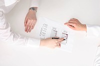 Hand of woman pointing at a document with a pen, and explaining it (thumbnail)