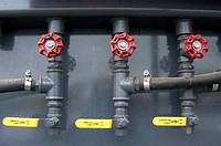 Detail of pressure valves on plant hire machinery