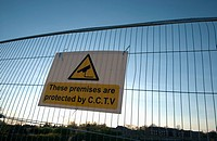 Fence around a development site preventing public access with warning sign