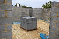 Stack of concrete breezeblocks on a house building site