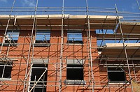 Scaffolding surrounding a new housing development