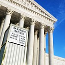 Courtroom lecture schedule sign in front of Supreme Court building in Washington D.C