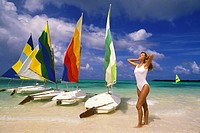 Woman on beach with sailboats, Punta Cana, Dominican Republic, Caribbean