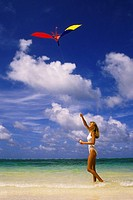 Woman on beach flying a kite, Punta Cana, Dominican Republic, Caribbean